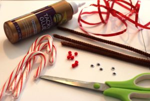 christmas-craft-supplies-needed to make a reindeer laid out on the table