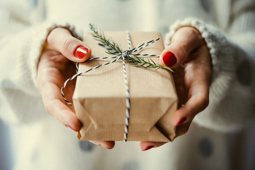 Woman's hands giving a diy holiday and christmas gift ideas