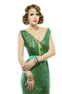 woman wearing a green retro sequin New Year's Eve Outifit