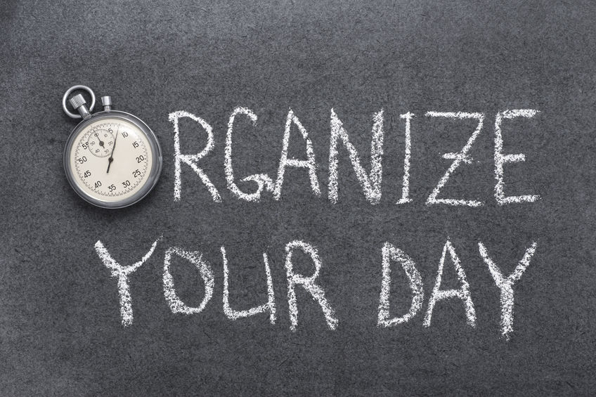 organize your day phrase handwritten on chalkboard with vintage precise stopwatch used instead of o