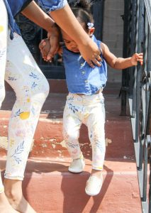 mother and daughter matching spring outfits - white floral pants with blue jean shirt