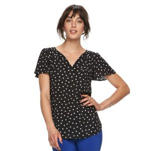 spring outfits - woman wearing black and white polka dot shirt