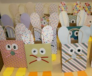Brown craft bags used in an easter craft for kids made into bunnies with construction paper