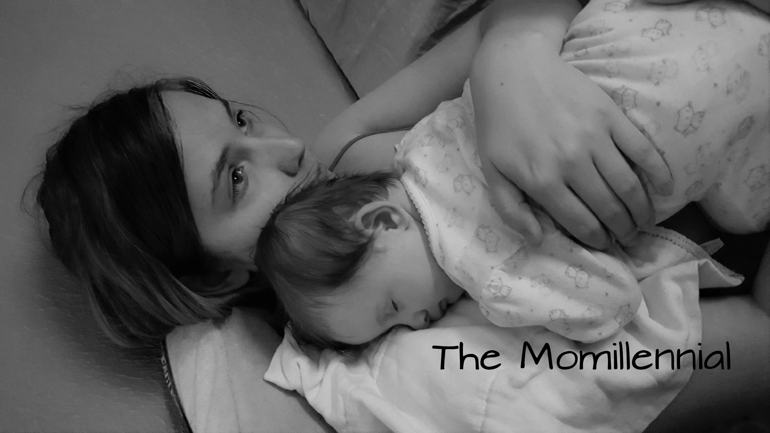 Black and white image of Freelancer and mom Josie S. Laying with her daughter on her chest
