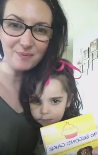 mother and daughter in a kitchen with baking supplies ready for a baking with kids lesson to make a cake