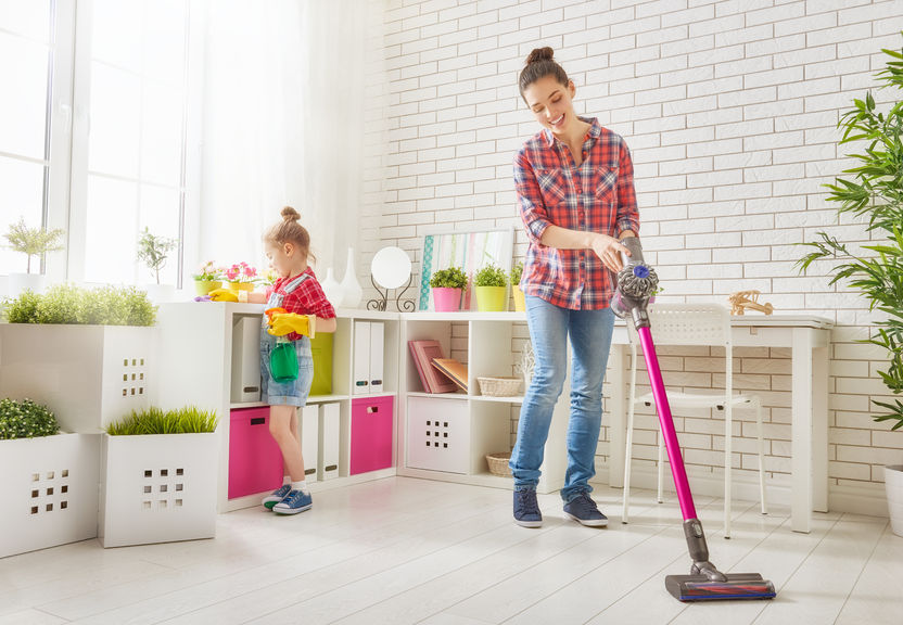 quick cleaning tips for busy moms with toddlers mother and a little girl wipe the dust and vacuum the floor