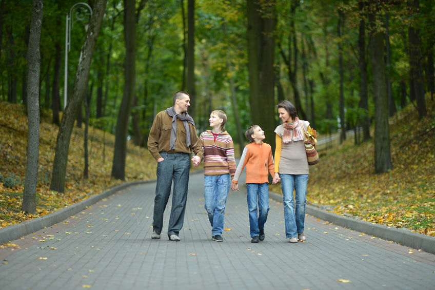 how to be a better mom happy family walking side by side in autumn park
